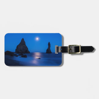 Moonrise reflection on ocean and sea stacks luggage tag