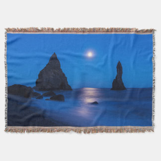 Moonrise reflection on ocean and sea stacks throw blanket