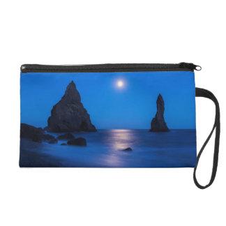 Moonrise reflection on ocean and sea stacks wristlet purse