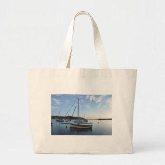Moored sailing cutter at dawn. large tote bag