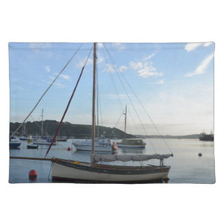 Moored sailing cutter at dawn. placemat