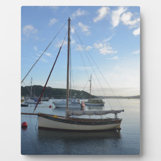 Moored sailing cutter at dawn. plaques