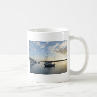 Moored yacht at dawn. coffee mug