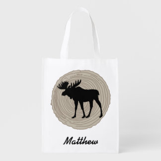 Moose with tree rings in background reusable grocery bag