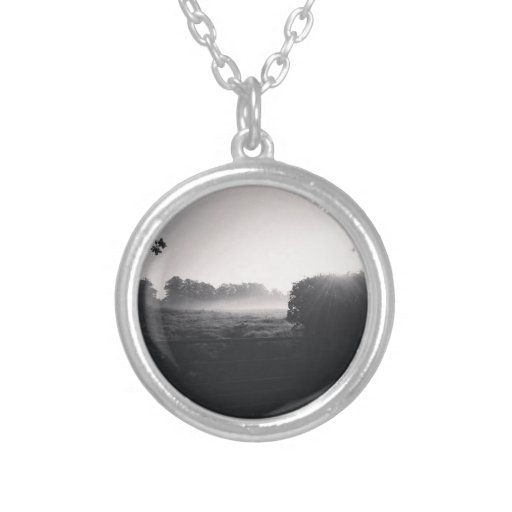 Morning mist and low sun on the field when droppib personalised necklace