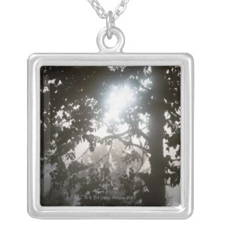 Morning sunlight through foliage of jungle silver plated necklace