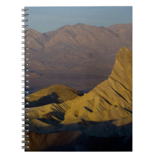 Mornings first light on  Zabriskie Point and 3 Spiral Notebooks