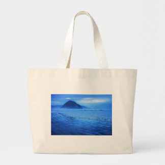 Morro Rock with seascape and sand Tote Bags