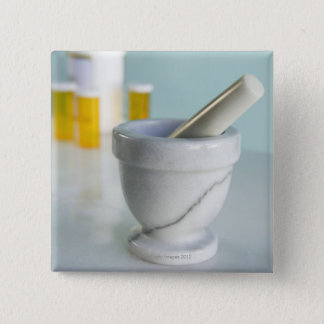 Mortar and pestle, pill bottles in background 15 cm square badge