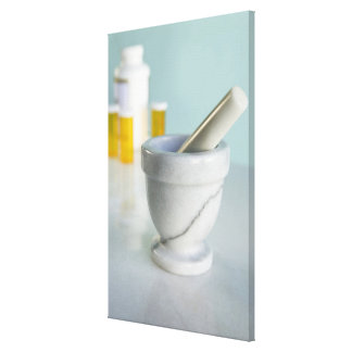 Mortar and pestle, pill bottles in background canvas print