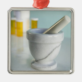 Mortar and pestle, pill bottles in background christmas ornament