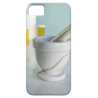 Mortar and pestle, pill bottles in background iPhone 5 cases