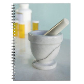 Mortar and Pestle, Pill Bottles in Background Notebook