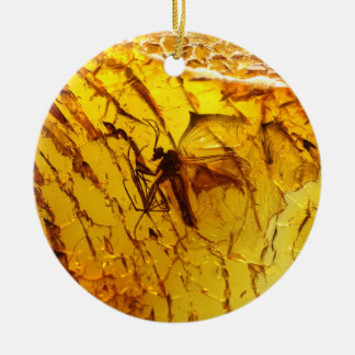 Mosquito inside amber round ceramic decoration