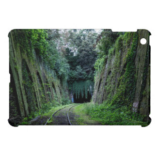 Moss and vines covering an abandoned rail track iPad mini cover