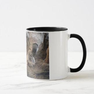 Mother and baby joey koalas asleep cuddling on mug