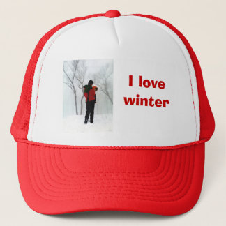 Mother and child in the snow trucker hat