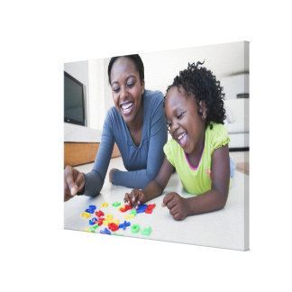Mother and daughter playing with letters canvas print