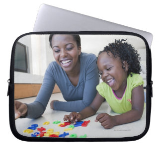 Mother and daughter playing with letters laptop sleeve