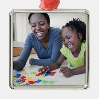 Mother and daughter playing with letters Silver-Colored square decoration
