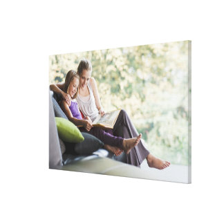 Mother and daughter reading storybook canvas print