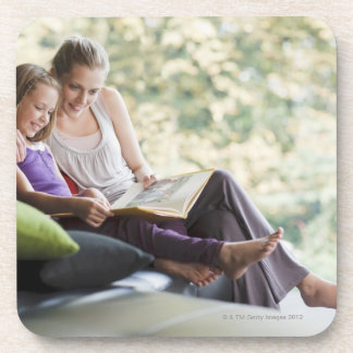 Mother and daughter reading storybook coaster