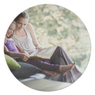 Mother and daughter reading storybook plate