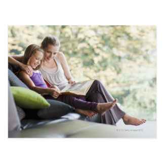 Mother and daughter reading storybook postcard
