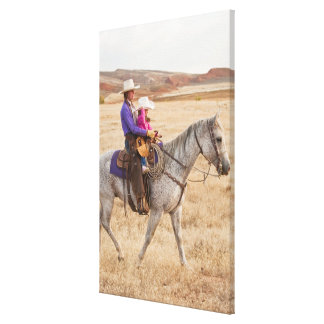 Mother and daughter riding horse canvas print