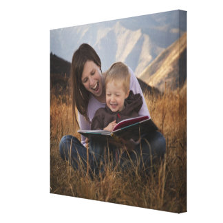 Mother and son reading outdoors canvas print