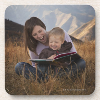 Mother and son reading outdoors coasters