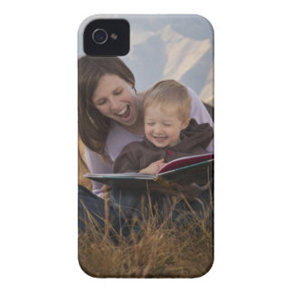 Mother and son reading outdoors iPhone 4 Case-Mate cases