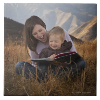 Mother and son reading outdoors tile