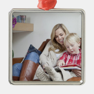 Mother and son sitting on sofa together christmas ornament