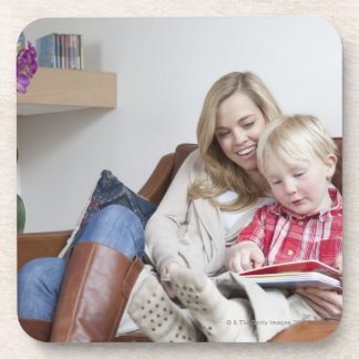 Mother and son sitting on sofa together coaster