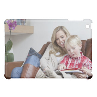 Mother and son sitting on sofa together iPad mini cover