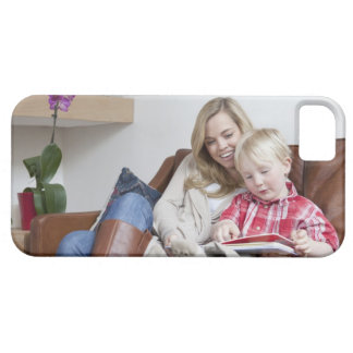 Mother and son sitting on sofa together iPhone 5 cases
