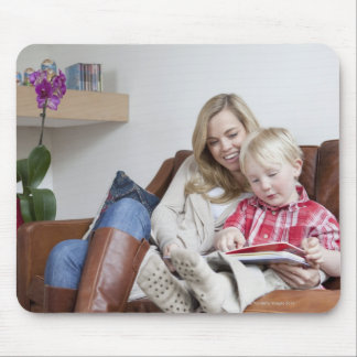 Mother and son sitting on sofa together mouse mat