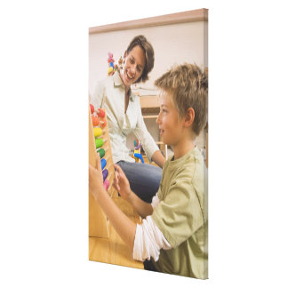 Mother and son using abacus canvas print