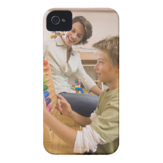 Mother and son using abacus iPhone 4 cover