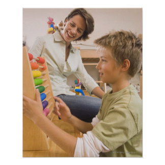 Mother and son using abacus poster