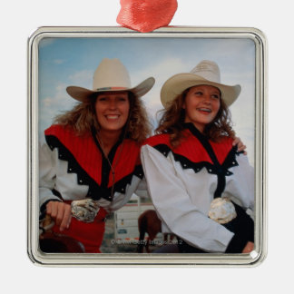 Mother and teenage daughter (14-16) at rodeo, christmas ornament