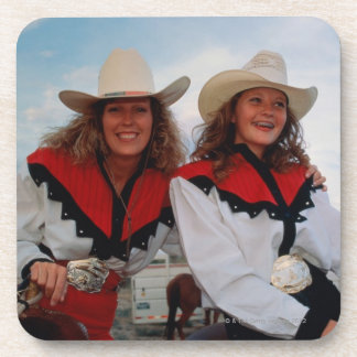 Mother and teenage daughter (14-16) at rodeo, coaster
