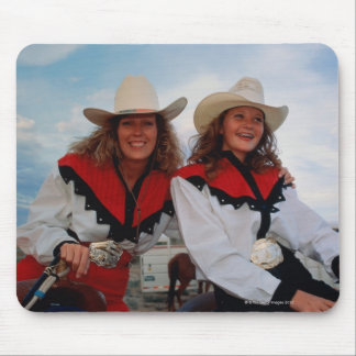 Mother and teenage daughter (14-16) at rodeo, mouse pad