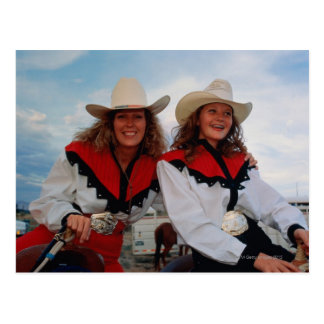 Mother and teenage daughter (14-16) at rodeo, postcard
