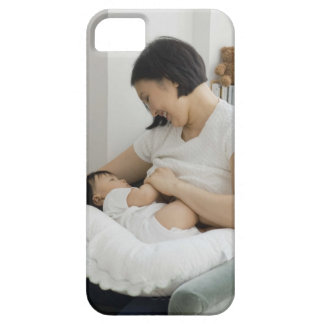 Mother breast feeding baby girl iPhone 5 covers