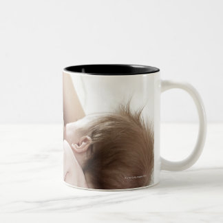 Mother breastfeeding baby 2 Two-Tone coffee mug