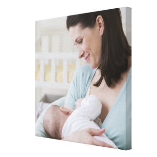 Mother breastfeeding baby canvas print
