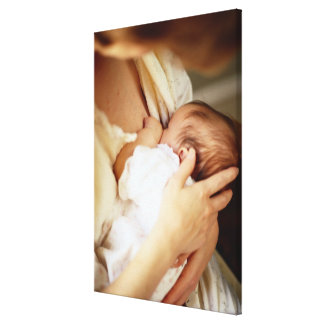 Mother breastfeeding baby girl (1-3 months) canvas print