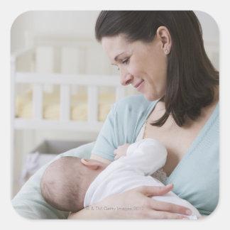 Mother breastfeeding baby square sticker